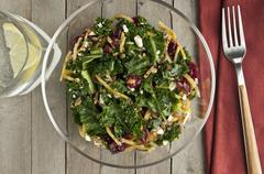 Kale salad with lingonberries Stock Photos