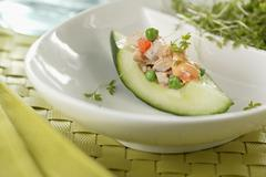 A cucumber boat with tuna fish salad Stock Photos