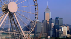 FERRIS WHEEL SKYSCRAPER PEIRS WATERFRONT HONG KONG Stock Footage