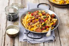 Fusilli salad with chorizo, pepper and onions Stock Photos