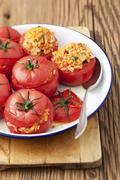 Baked tomatoes stuffed with rice Stock Photos