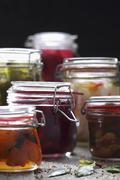 Sliced Pickles and Beets in Mason Jars Stock Photos