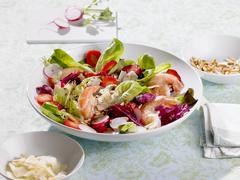 A colourful salad with prawns, strawberries and radishes Stock Photos