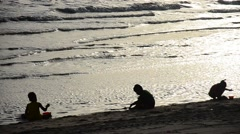 Thai children playing sand on the beach Stock Footage