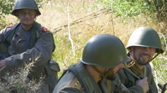 Soldiers talking an waiting in camp near frontline Stock Footage