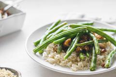Beef with rice and green beans Stock Photos