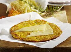 A potato fritter topped with Appenzeller cheese Stock Photos
