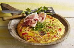 Catalan tortilla with peppers and Serrano ham Stock Photos
