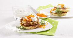 Cauliflower blinis with salmon trout caviar Stock Photos