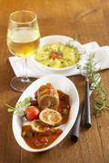 Pork roulade with a potato gratin Stock Photos