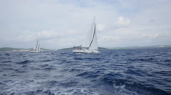 Sailing ship yachts with white sails in open Sea. Stock Footage