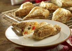 Puff pastries filled with a spicy quark filling Stock Photos