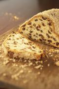 Wholemeal spelt stollen, sliced (close-up) Stock Photos