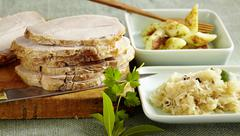 Polish roast pork with sauerkraut and potato pasta Stock Photos