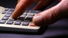 Man's hand using a calculator. Stock Footage