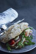 Ciabatta sandwich with roast pork, rocket, hard-boiled eggs and tomatoes Stock Photos