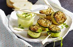 Scallops wrapped in courgette with aioli Stock Photos