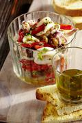 Squid salad with an anchovy dressing Stock Photos