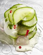 Spicy cucumber salad with onions and chilli peppers Stock Photos