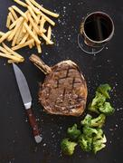 Prime rib steak with fries and broccoli Stock Photos