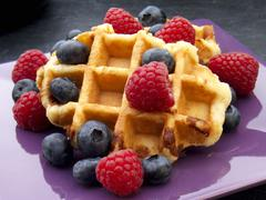 Waffles with fresh berries Stock Photos