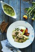 Cooked cod roe with a caper sauce and root vegetables Stock Photos