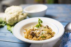 Risotto all'abruzzese (risotto with cauliflower and spicy sausage, Italy) Stock Photos
