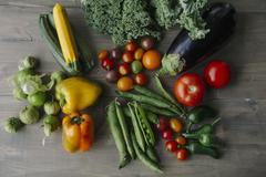 Assorted types of vegetables on a wooden surface Stock Photos