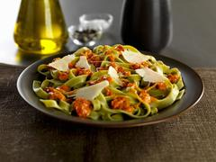 Tagliatelle verdi pasta with calabrese pesto and parmesan cheese shavings Stock Photos