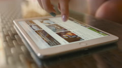 Girl in the cafe reads the news on the website bbc. 4K 30fps ProRes (HQ) Stock Footage