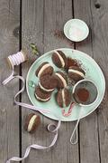 Cocoa biscuits filled with coconut cream Stock Photos