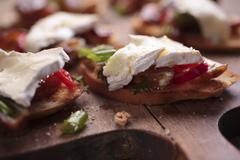 Grilled bread topped with brie and spicy dates Stock Photos