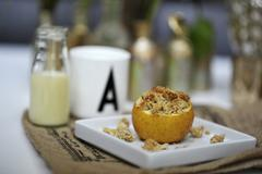 Stuffed baked apple with crumbles Stock Photos