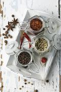 Various spices in storage jars on a tray Stock Photos