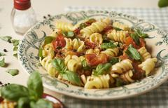 Fusilli pasta with tomatoes and basil Stock Photos