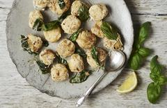 Gnudi with sage butter, basil and grated cheese Stock Photos