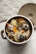 Czenaki (meat and vegetable stew from Eastern Europe) in a clay pot Stock Photos