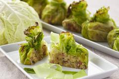 Stuffed, gratinated cabbage parcels Stock Photos