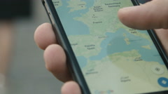 Looking up directions on a smart phone Stock Footage