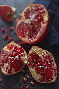 Pomegranate Broken Open to Expose Seeds Stock Photos