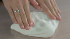 Woman's hands knead sugar mastic for making dessert Stock Footage
