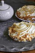 Meringue with flaked almonds Stock Photos