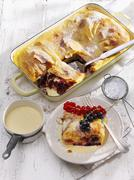 Cream strudel with redcurrants and blackcurrants Stock Photos