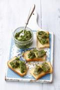 Toast topped with herring in salsa verde Stock Photos