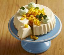 A mini creamy cheesecake with spicy mango salsa Stock Photos