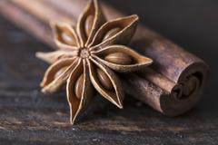Star anise and cinnamon sticks on a wooden surface Stock Photos