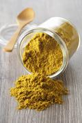 Curry powder in an overturned glass Stock Photos