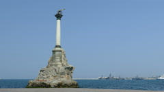 Warship and Monument to the Scuttled ships in Sevastopol Stock Footage
