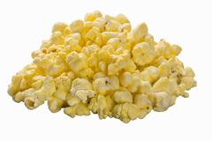 A pile of buttered popcorn on the white surface Stock Photos