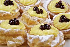 Zeppole di San Giuseppe (choux pastries filled with cream and amarena, Italy) Stock Photos